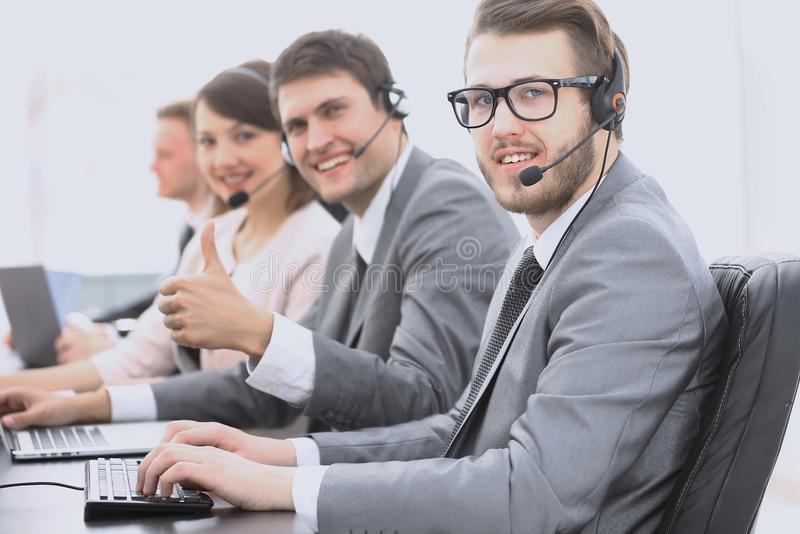 Employee call center with headset showing thumb up. Operator call center with headset showing thumb up stock photos