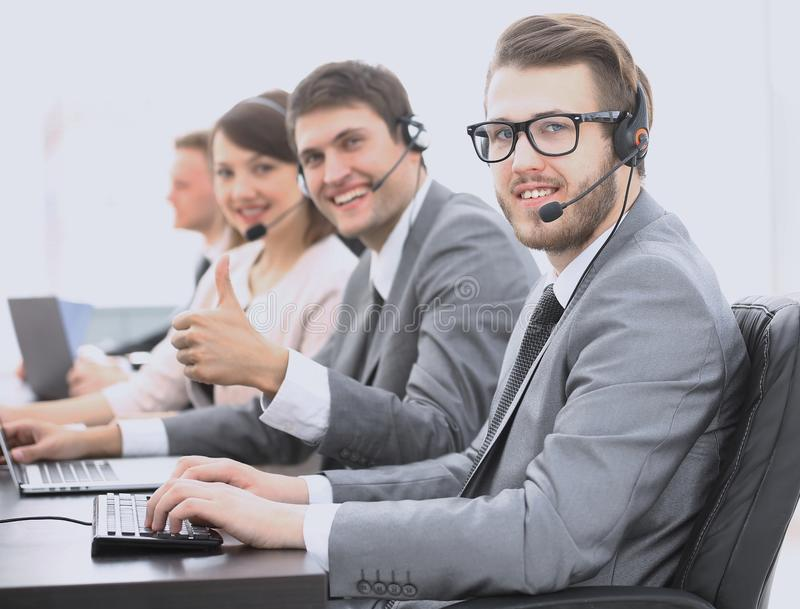 Employee call center with headset showing thumb up. Operator call center with headset showing thumb up stock photo