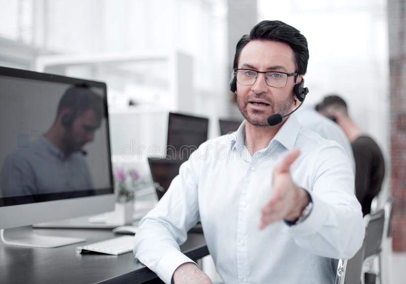 Operator call center holding out his hand for a handshake stock images