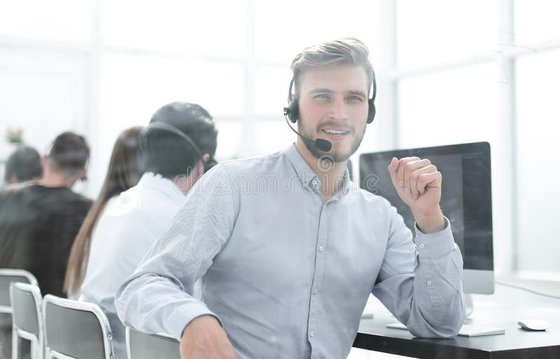 Operator call center in the workplace in a bright office royalty free stock photography