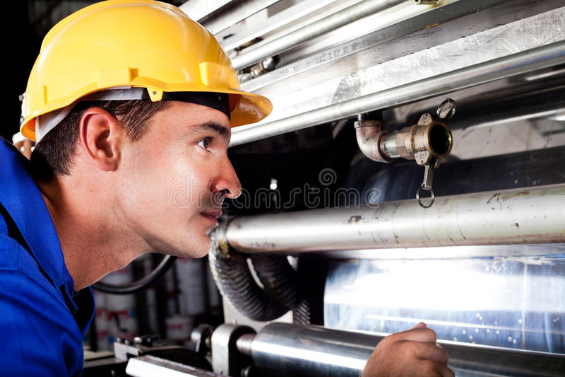 Download Operator Checking On Machine Stock Image - Image: 22988473