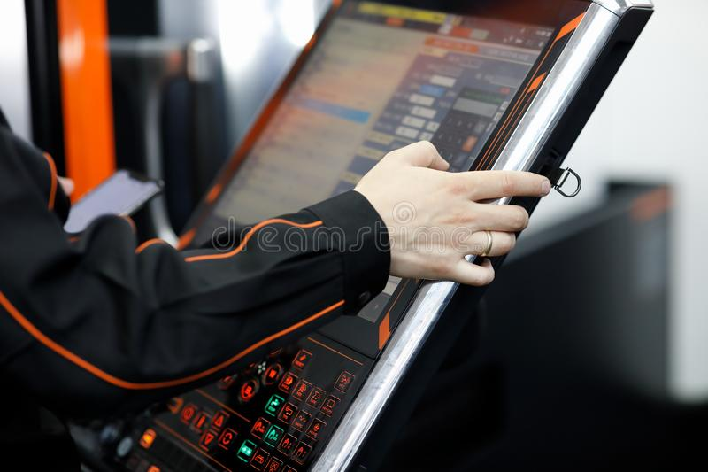 Operator working with touch screen control panel royalty free stock image