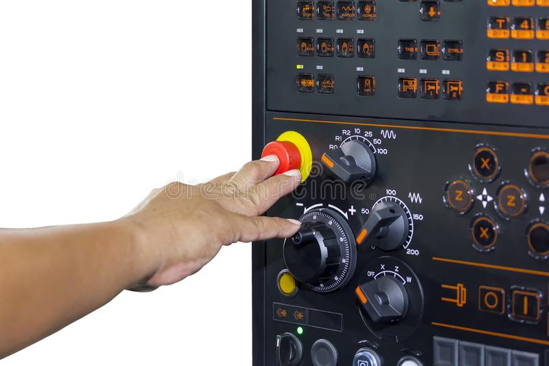 Operator use finger press emergency stop of control panel cnc lathe machine or machining center isolated on white background with stock photos