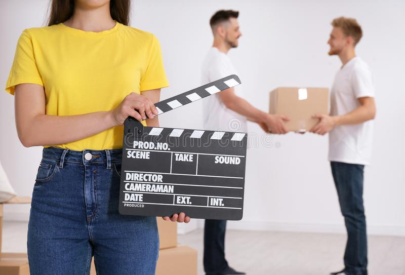 Operator holding clapperboard during the production indoors. Closeup stock image