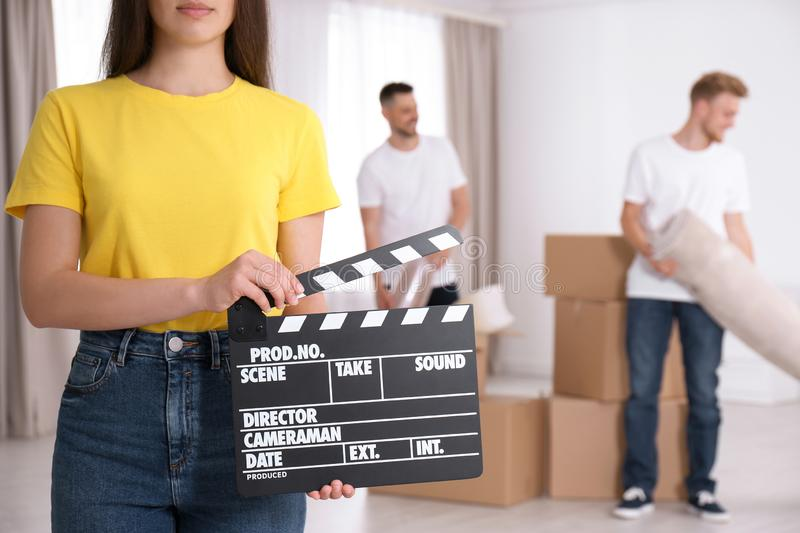 Operator holding clapperboard during the production indoors. Closeup stock photos