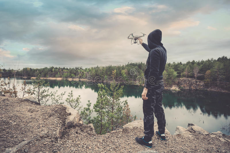 Operator holding quadrocopter in his hands before takeoff. Unmanned aerial copter. stock images