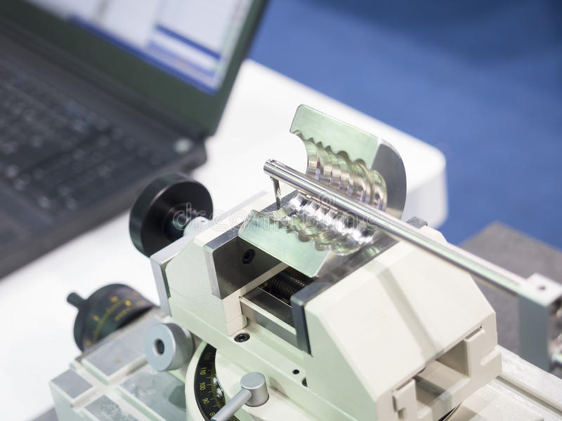 Operator inspection automotive part by contour measuring machine stock photography
