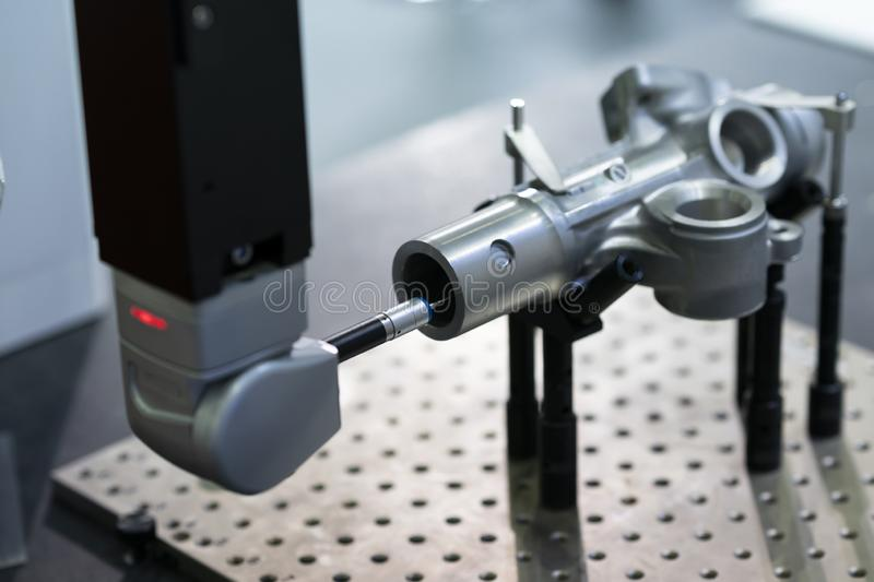 Operator inspection high precision part by CMM coordinate measuring machine stock image