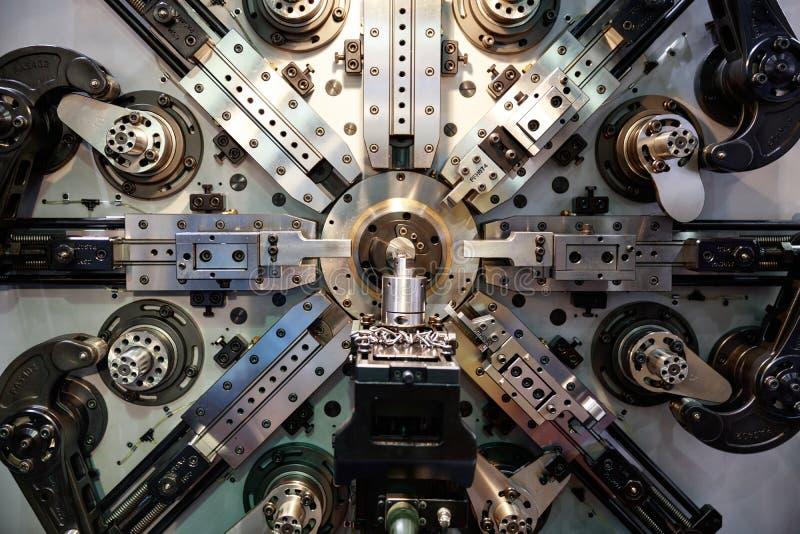 Operator machining automotive part by turning stock photos