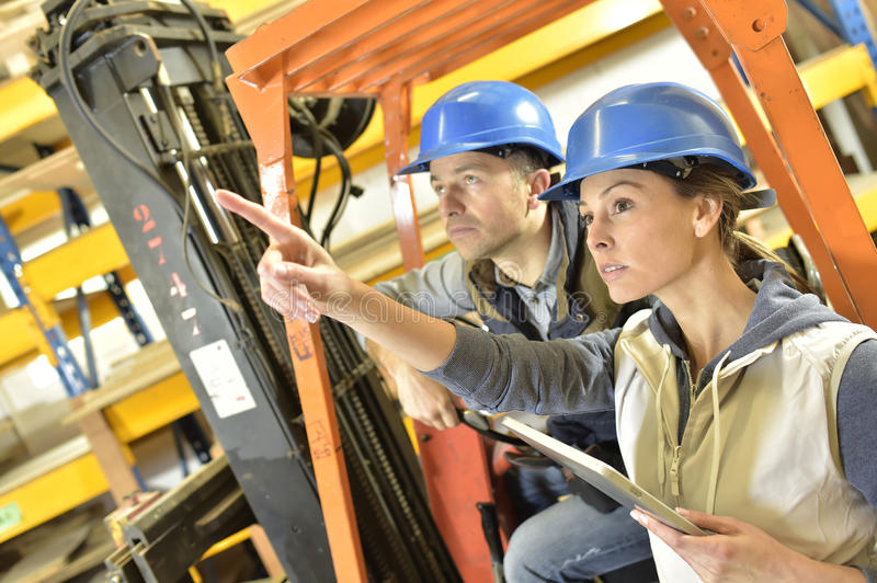 Operator and overseer working stock photos
