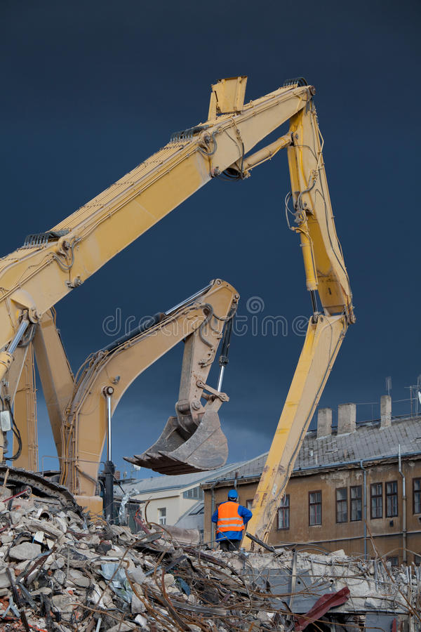 Operator oversees the demolition stock photo