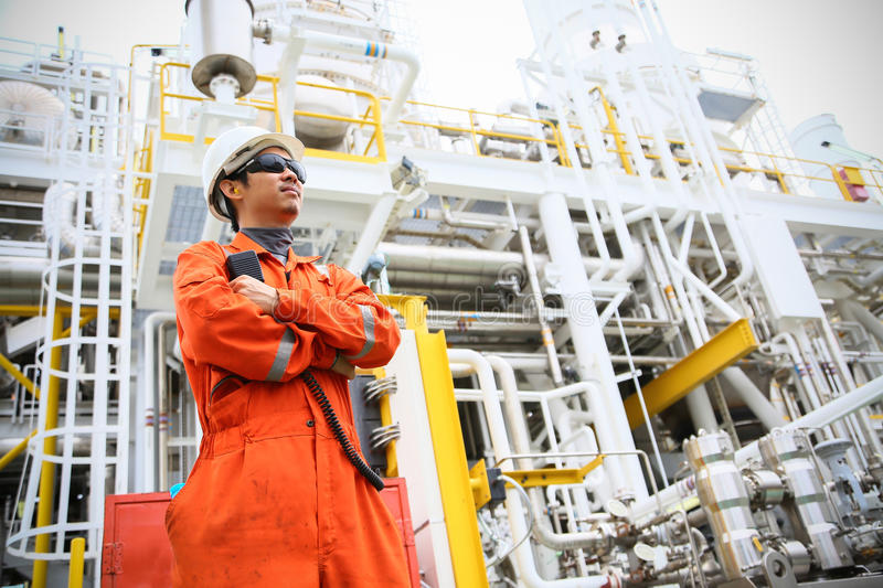 Operator recording operation of oil and gas process at oil and rig plant, offshore oil and gas industry, offshore oil and rig. In the sea, operator monitor stock photos