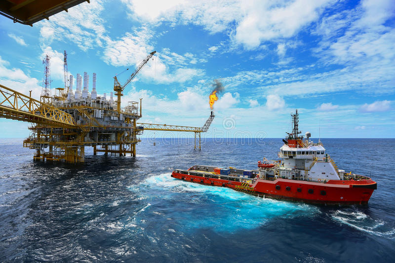 Operator recording operation of oil and gas process at oil and rig plant, offshore oil and gas industry, offshore oil and rig. In the sea, operator monitor stock photography