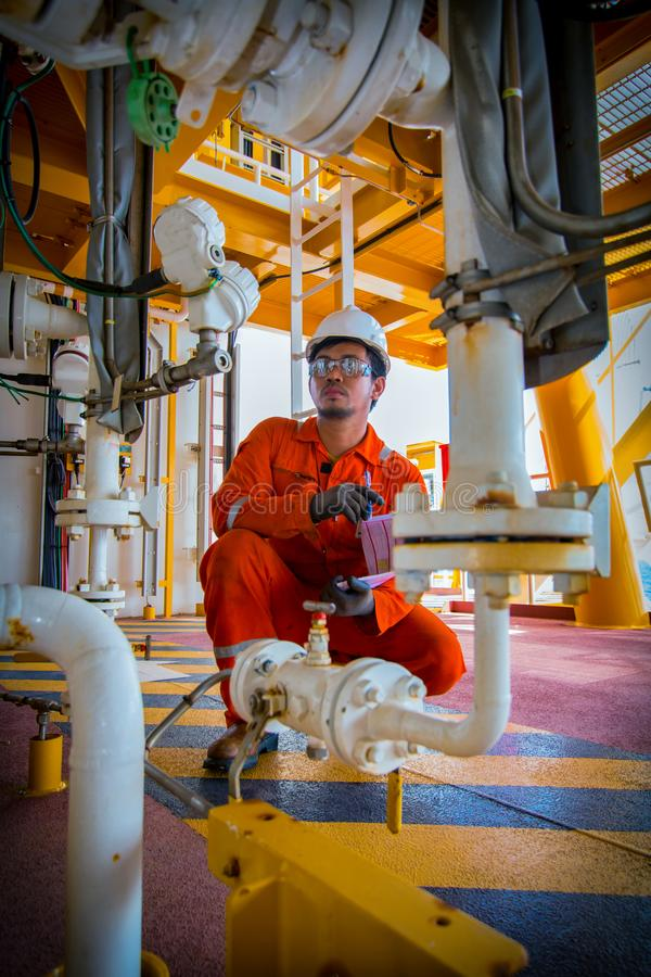 Operator recording operation of oil and gas process at oil and r. Ig plant, offshore oil and gas industry, offshore oil and rig in the sea, operator monitor stock images