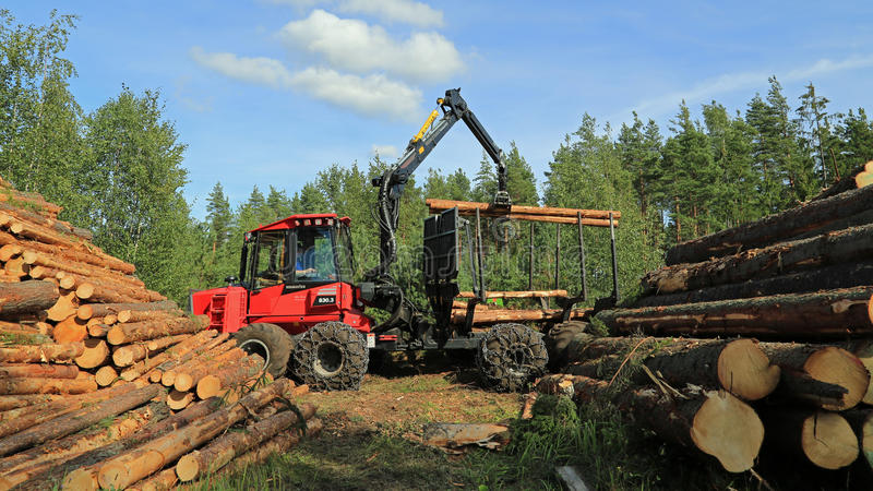 operator stacking up logs with komatsu 830 3 forestry