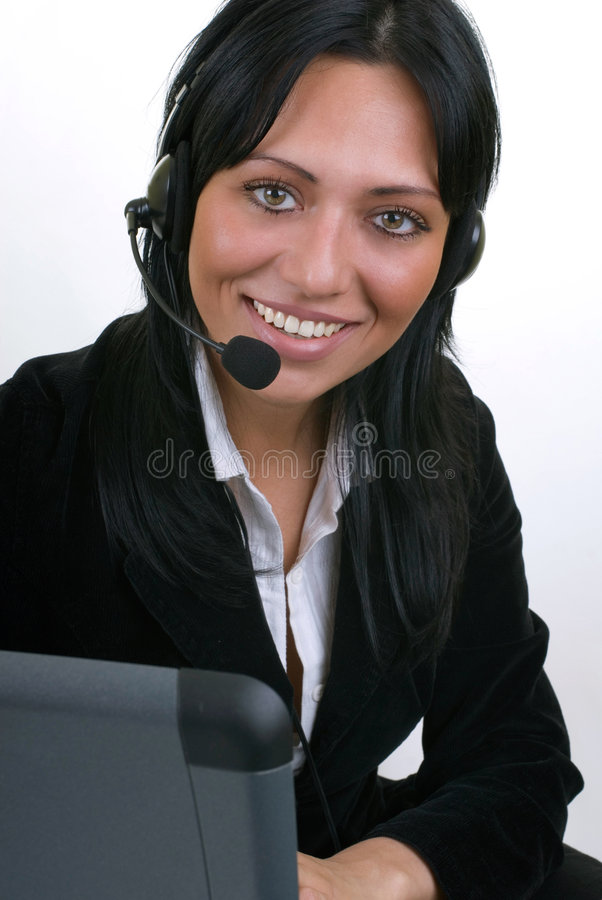 Operator at work. Beautiful girl with headset isolated on white royalty free stock image