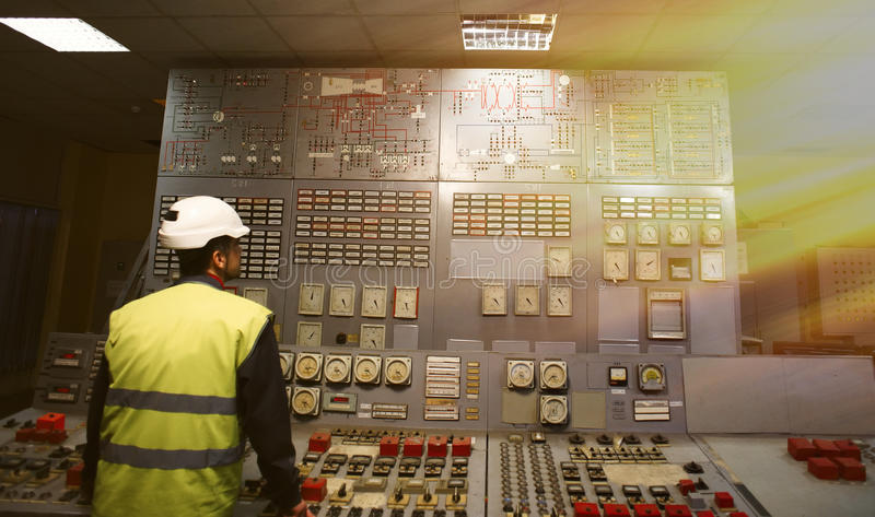 Operator at work place in the system control room. Of power plant stock photo