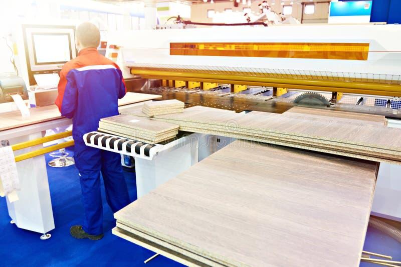 Operator worker near panel saw machine royalty free stock photos