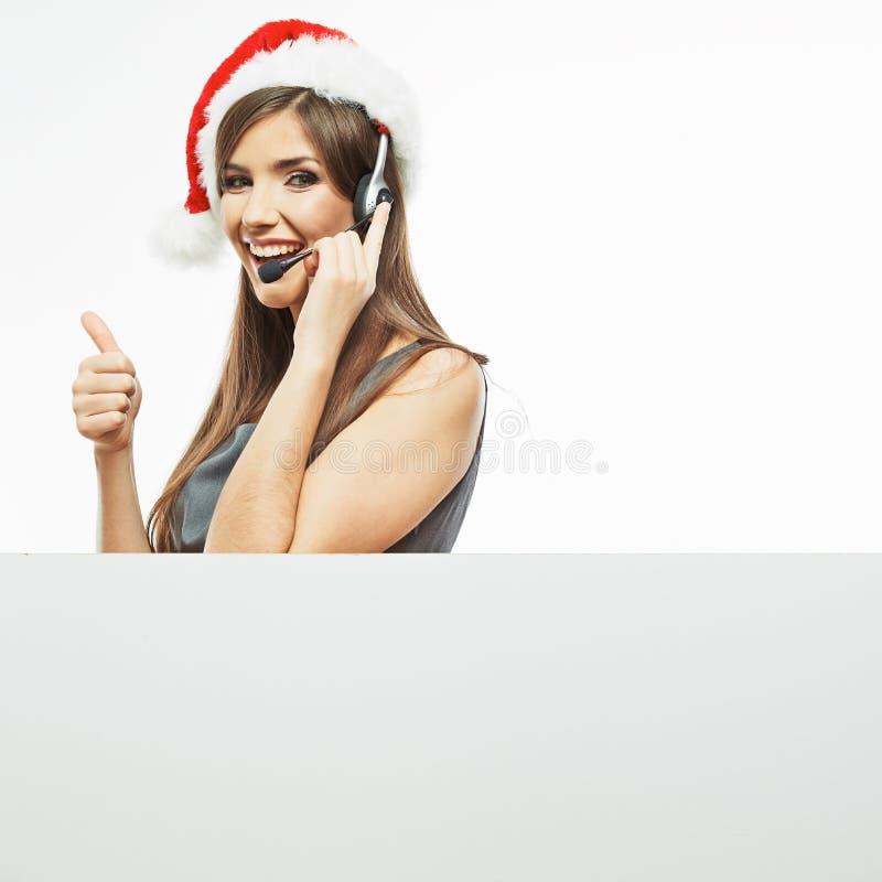 Operatora centrum telefonicznego kobieta, bożego narodzenia Santa kapelusz fotografia stock