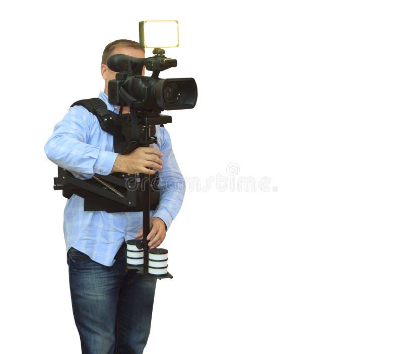 Operatore della videocamera che lavora con l'attrezzatura professionale immagini stock