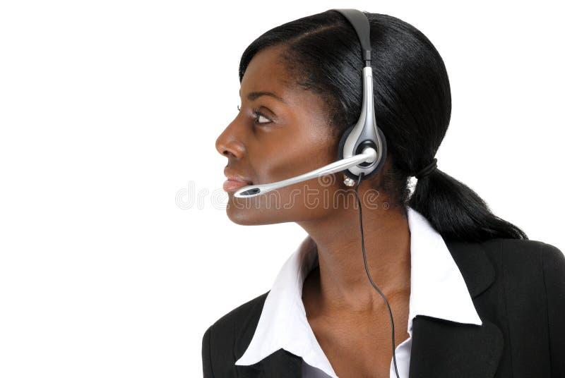 Operatore di sostegno di servizio di assistenza al cliente che osserva via fotografia stock