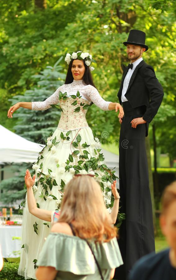 Operetta open air festival O-Fest in the central park. Young actors in retro wedding costumes on s stock image