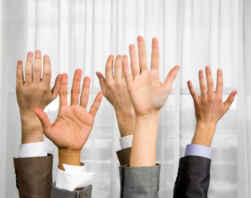 Opgeheven handen stock foto
