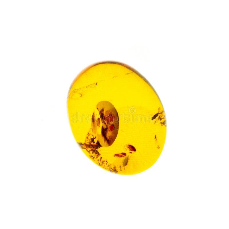 Opgepoetst cabochon van kunstmatige amber op witte geïsoleerde achtergrond royalty-vrije stock foto's