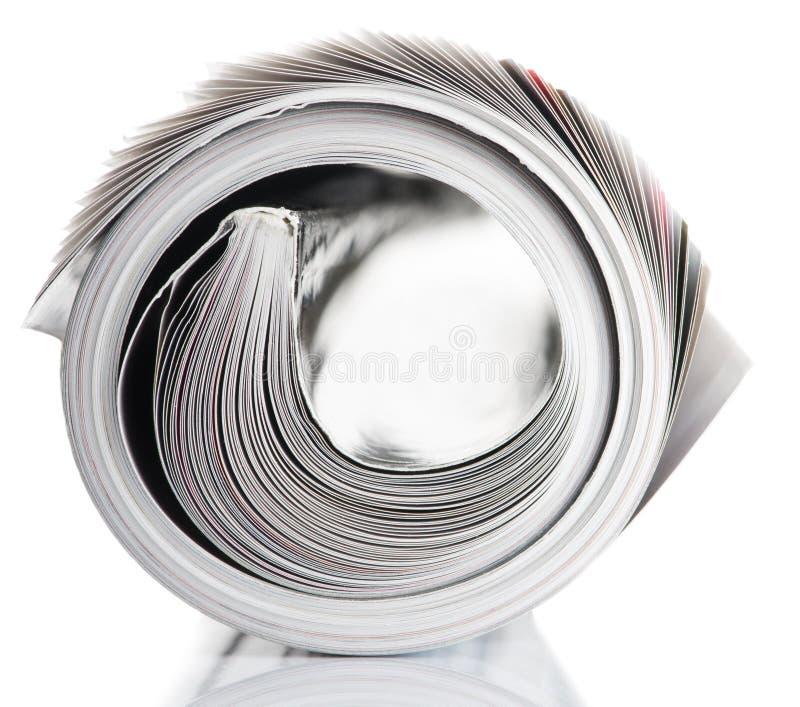 Opgerold tijdschrift royalty-vrije stock afbeelding