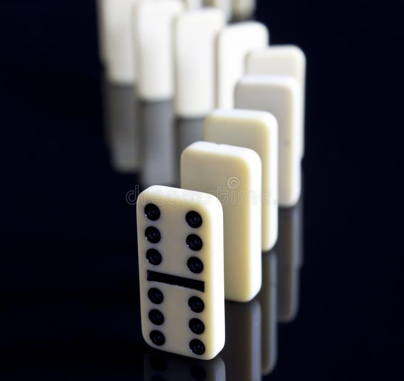 Opgestaane domino's royalty-vrije stock afbeeldingen