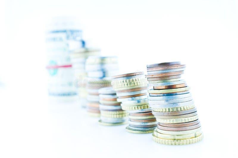 Opgestapelde muntstukken stock afbeeldingen