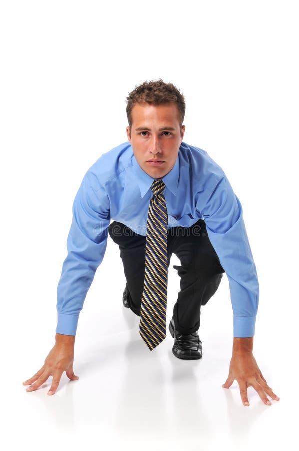 Opgesteld zakenman klaar voor ras in zaken stock afbeeldingen