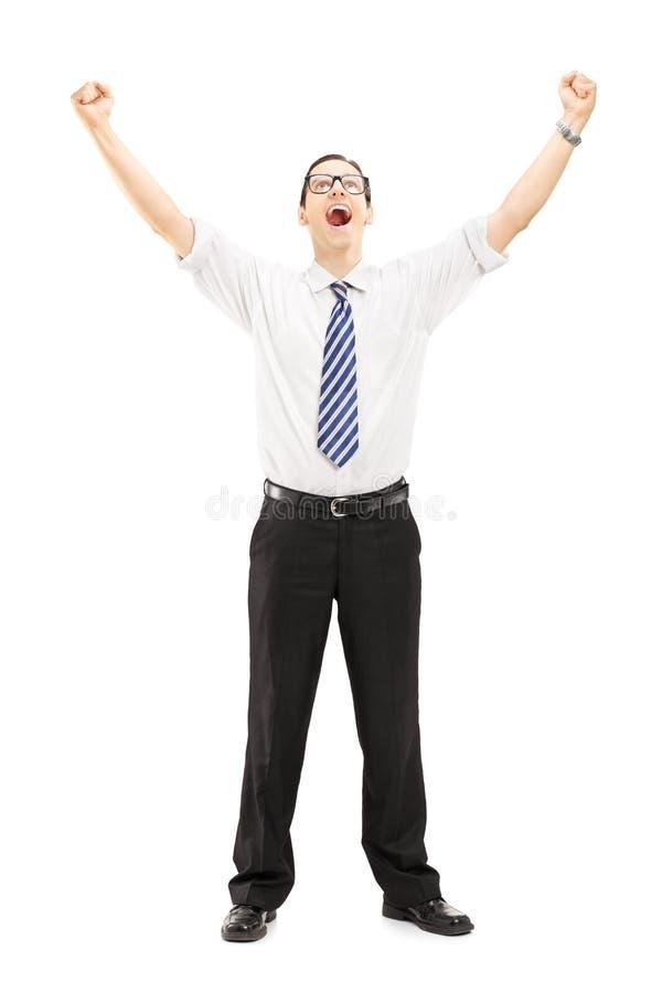Opgewekt mannetje met opgeheven handen die geluk gesturing stock afbeelding