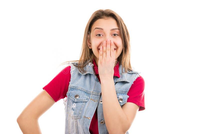 Opgewekte jonge vrouw die mond behandelen stock fotografie