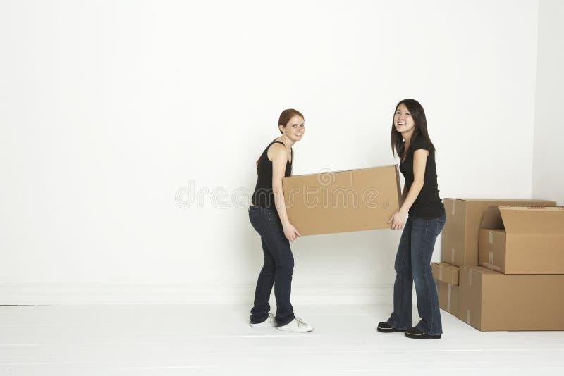 Opheffende doos in eerste flat stock fotografie