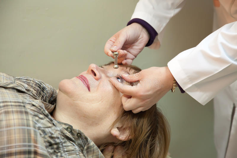 Download Ophthalmologist Measures The  Ocular Tension Stock Image - Image: 22744545