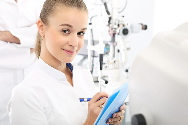 Ophthalmologist. Young attractive doctor ophthalmologist at an ophthalmologist royalty free stock photos