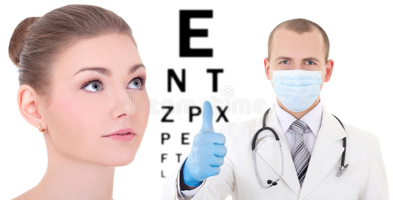 Ophthalmology concept - beautiful woman with doctor isolated on. Ophthalmology concept - beautiful women with doctor isolated on white background stock photography