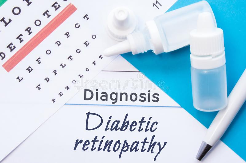 Ophthalmology diagnosis Diabetic retinopathy. Snellen eye chart, two bottles of eye drops medications lying on notebook with. Title Diabetic retinopathy stock image