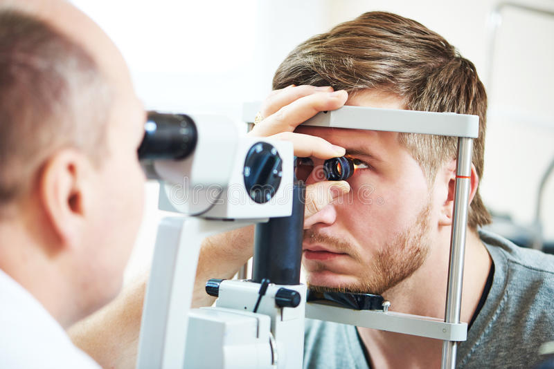 Ophthalmology eyesight examination. Ophthalmology concept. Male patient under eye vision examination in eyesight ophthalmological correction clinic stock photo