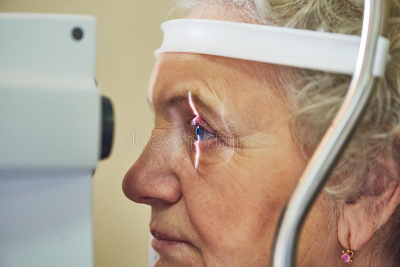 Ophthalmology. eyesight check of adult female woman royalty free stock image