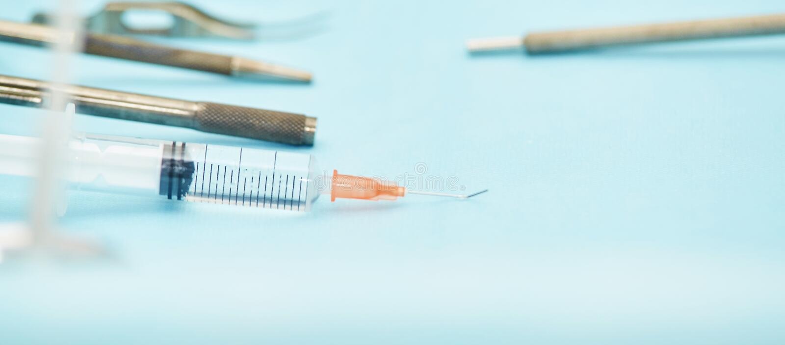 Ophthalmology laser microscope operation. Clinic room with doctor and parient. Gloves and medicine tools.  stock photography