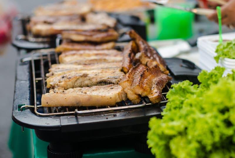 Opieczenie wieprzowina w rynku obraz royalty free
