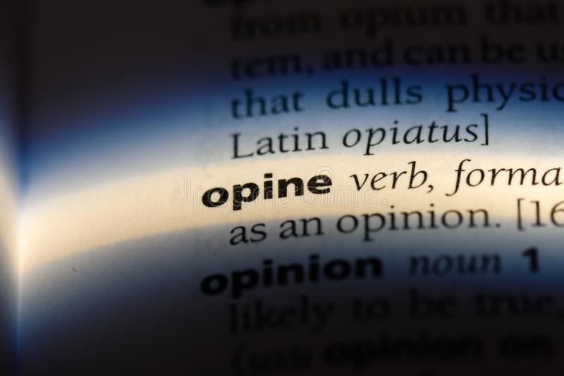 Opine. Word in a dictionary.  concept royalty free stock image
