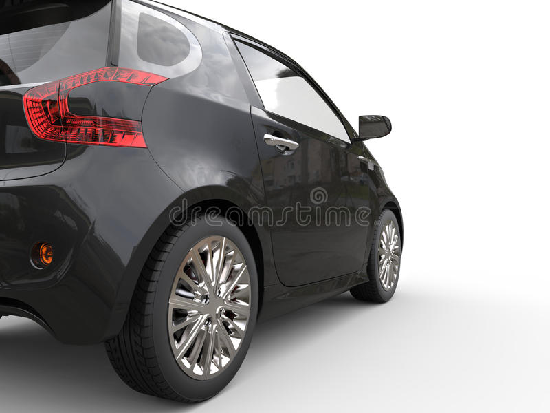 Opinião automobilístico compacta preta do close up da lanterna traseira foto de stock