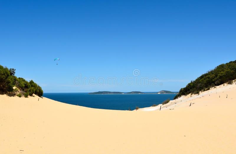 Opinião Carlo Sandblow, acima da praia do arco-íris em Queensland fotografia de stock