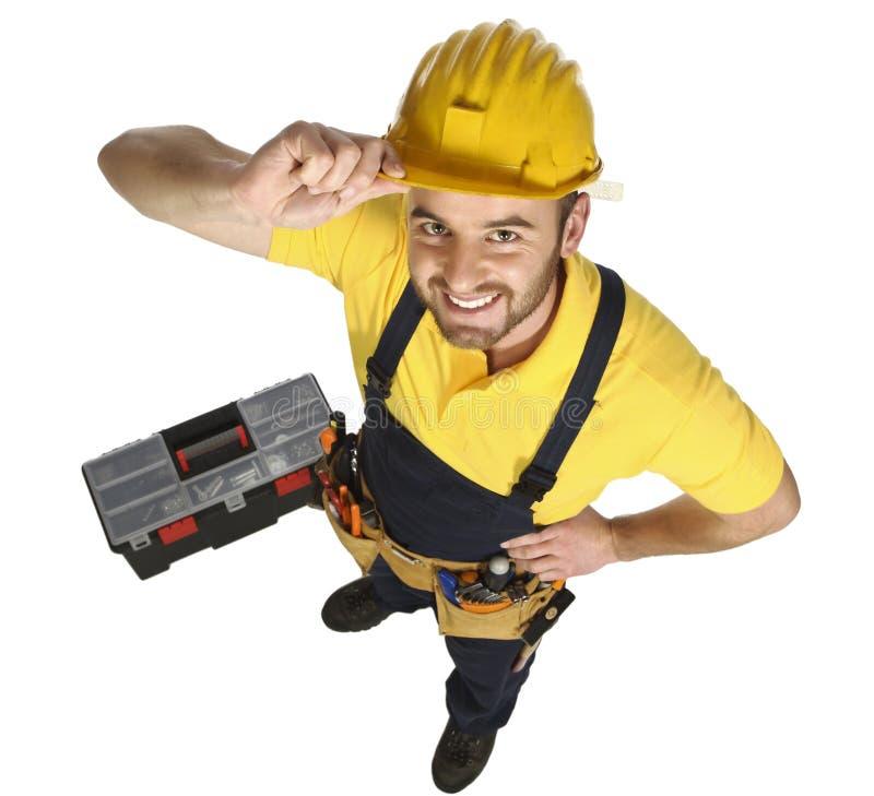 Opinião caucasiano ereta do divertimento do trabalhador manual de acima foto de stock