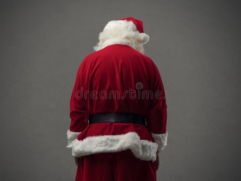 Opinião da parte traseira de Santa Claus imagens de stock royalty free