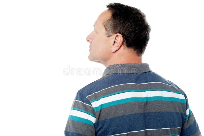Opinião da parte traseira do homem superior isolada no branco imagens de stock royalty free