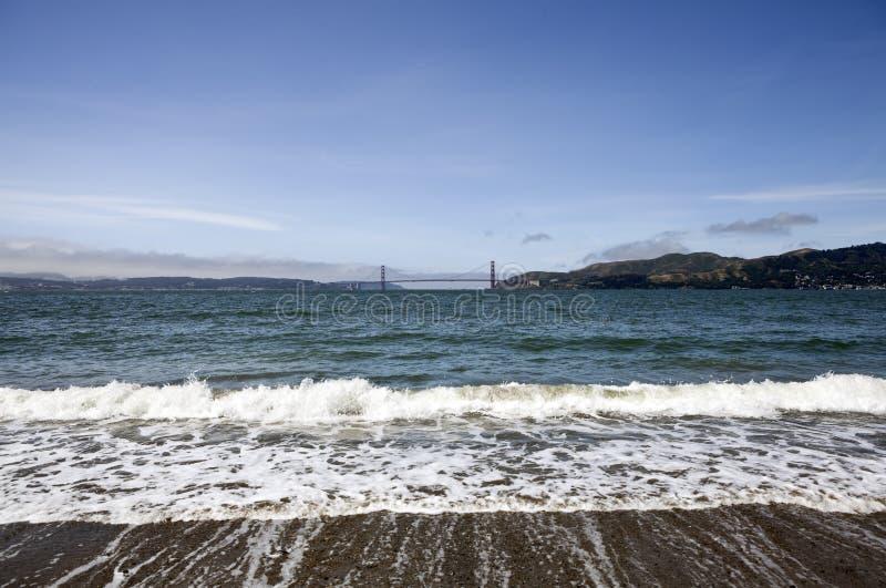 Opinião de porta dourada da praia do console do anjo imagens de stock